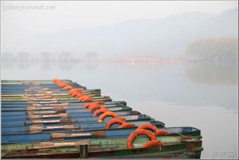 rowboats on lake