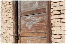 wood door brick house