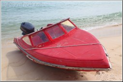 red beached boat