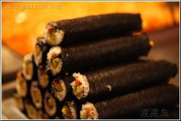 stacked sushi rolls